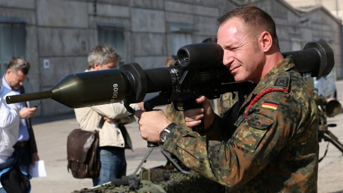 A member of the German army Bundeswehr presents a weapon which is part of a military aid for Iraq during a press event in Waren, northeastern Germany, Thursday, Sept. 18, 2014.   AP