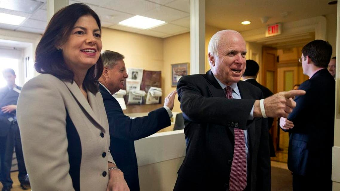 Sen. Lindsey Graham and Senate Armed Services Committee Chairman Sen. John McCain arrive before a news conference on Capitol Hill in Washington, Jan. 13, 2015 | AP