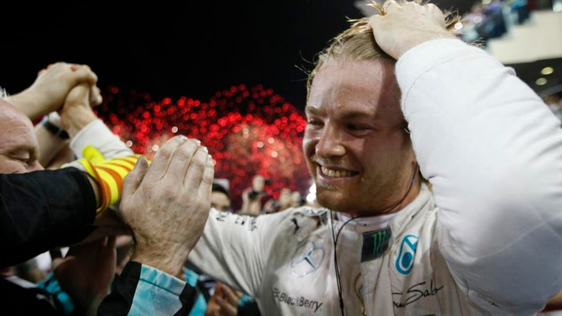 Mercedes driver Nico Rosberg of Germany celebrates with ten members after winning the Emirates Formula One Grand Prix at the Yas Marina racetrack in Abu Dhabi, United Arab Emirates, Sunday, Nov. 29, 2015. (AP Photo/Luca Bruno)