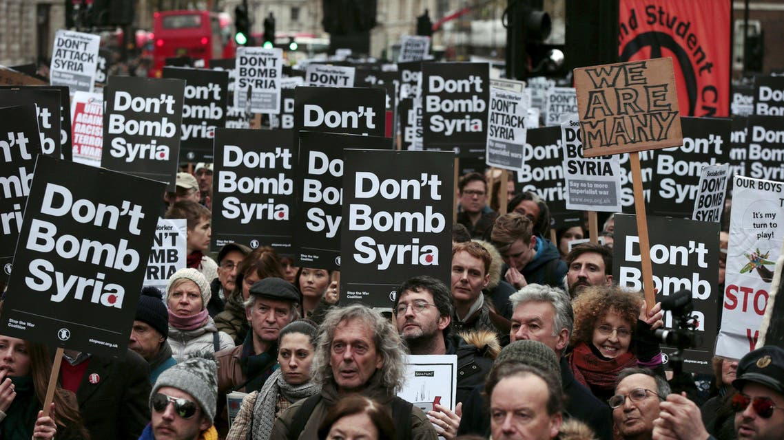 Demonstrators listen to speakers at a rally against taking military action against ISIS in Syria, held outside Downing Street in London, November 28, 2015. (Reuters)