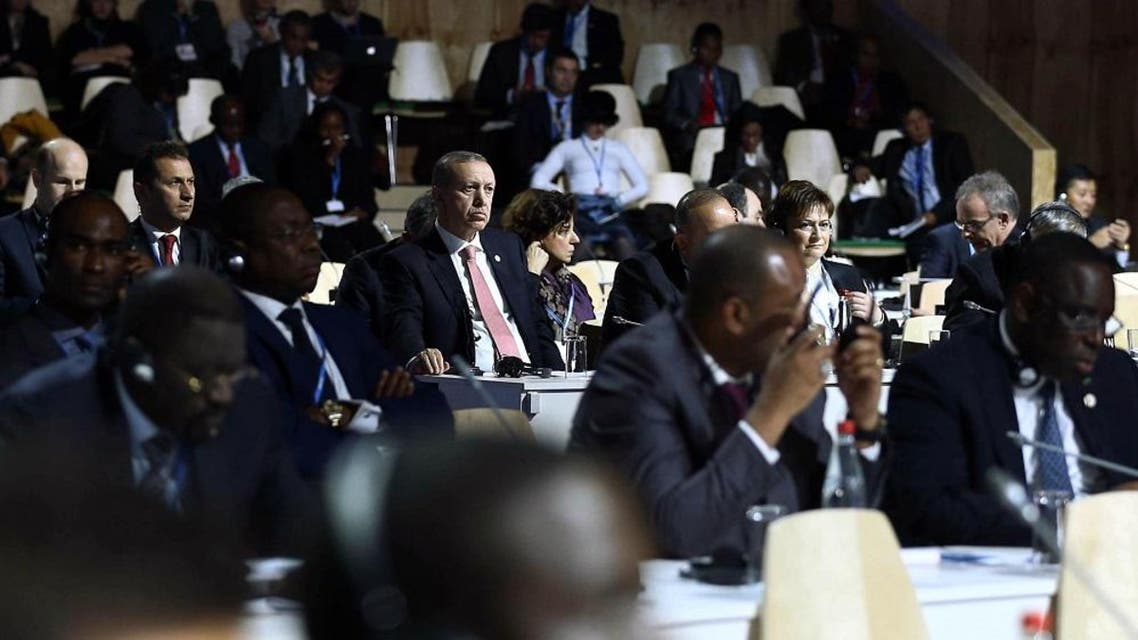 Turkey's President Recep Tayyip Erdogan, center left, listens to statements at the COP21, United Nations Climate Change Conference, in Le Bourget, outside Paris, France, Monday, Nov. 30, 2015. (AP Photo/Yasin Bulbul, Presidential Press Service, Pool)