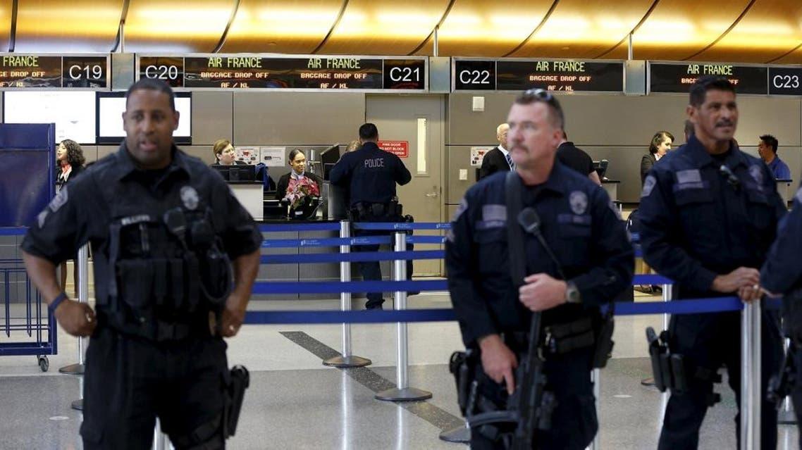 Los Angeles Airport Police officers keep watch inside Tom Bradley International Terminal at Los Angeles Airport in Los Angeles, California November 24, 2015 | Reuters\