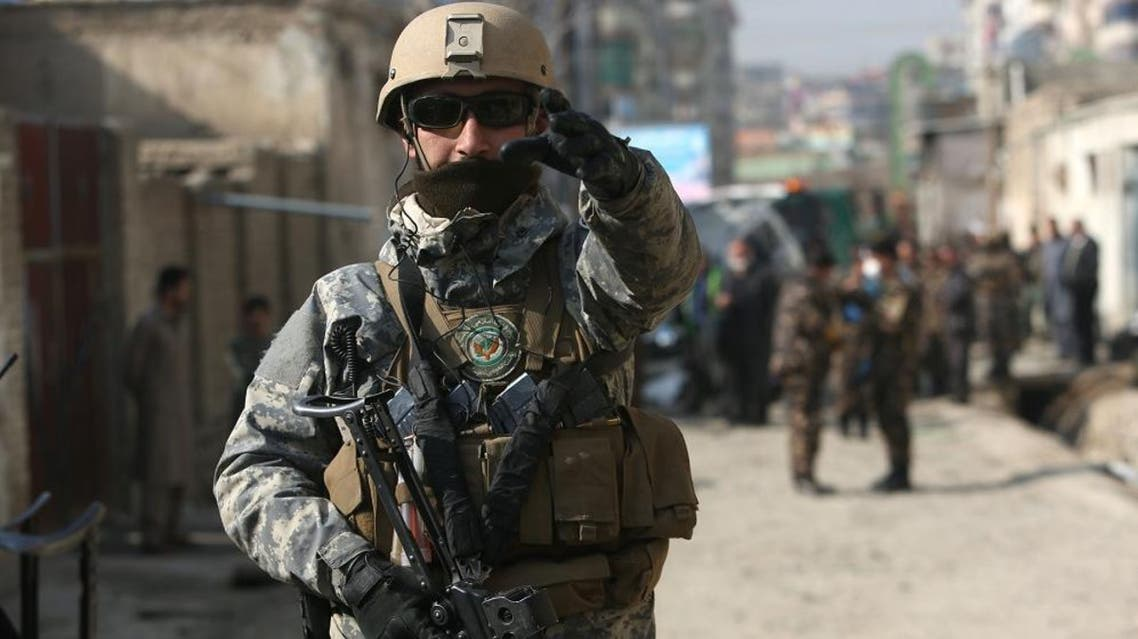 Afghan security forces inspect the site of a suicide attack in Kabul, Afghanistan, Saturday, Nov. 28, 2015. Afghanistan's election commission says one of its officials escaped unharmed after a suicide bomber targeted his vehicle in the capital, Kabul, killing his bodyguard and wounding his driver. (AP Photo/Rahmat Gul)