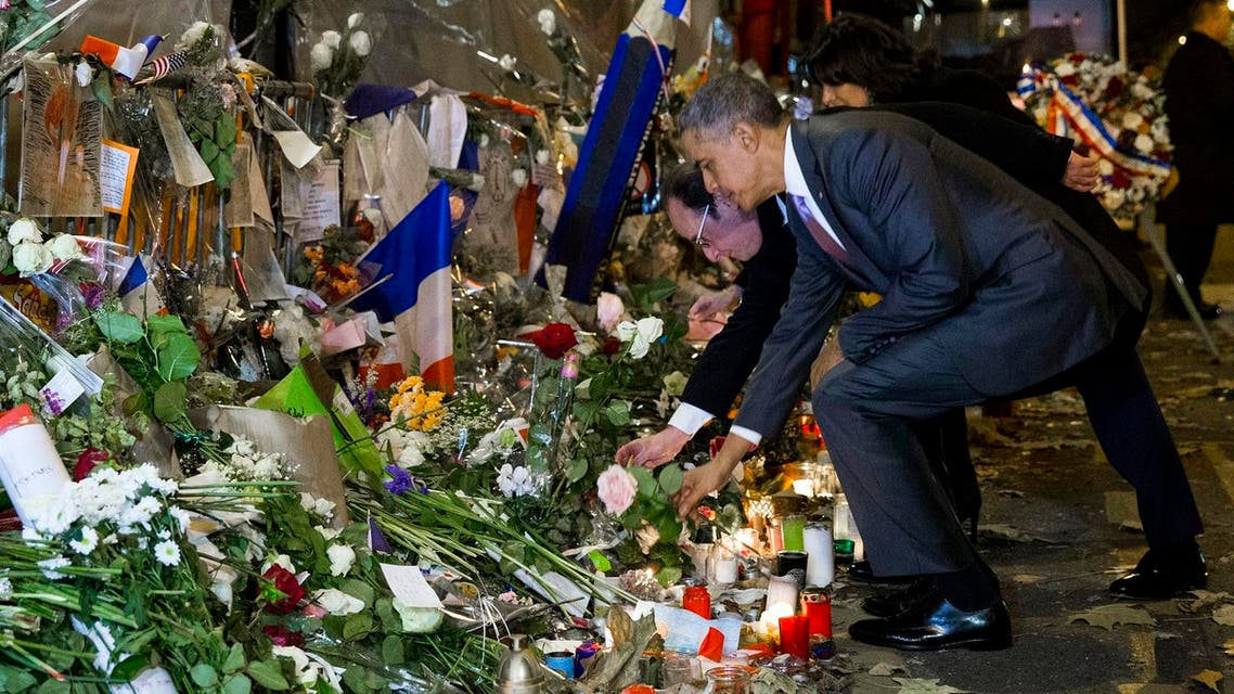 Obama places flowers at the Bataclan memorial to pay respects after arriving in town for the COP21 climate change conference. (AP)