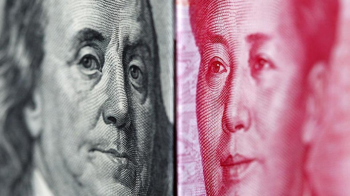 A 100 yuan banknote is placed beside a U.S. 100 dollar banknote in this illustrative file photograph taken in Taipei on June 20, 2010 | Reuters