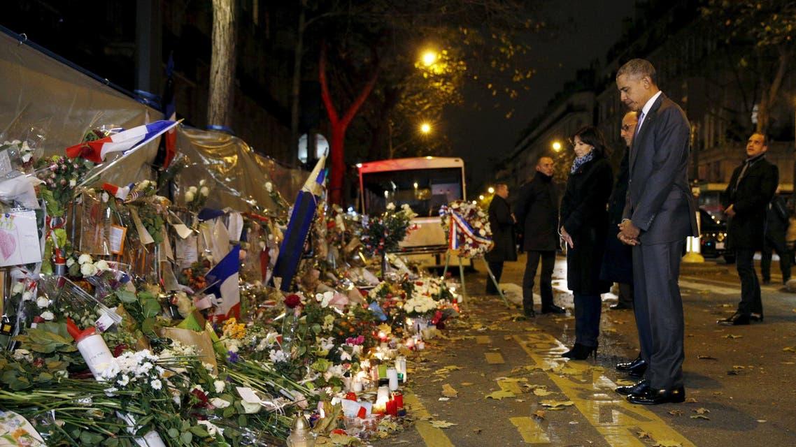 هولاند وأوباما في مسرح هجمات باريس