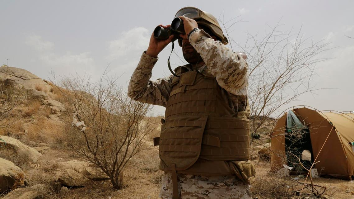 A Saudi soldier looks with binoculars toward the border with Yemen in Jazan, Saudi Arabia. (File photo: AP)