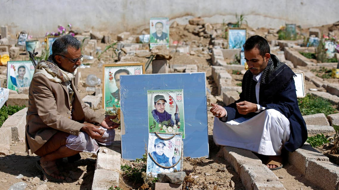 Yemeni Shiites, known as Houthis, offers prayers at the grave of their relative who was killed during fighting in Taiz city, at cemetery in Sanaa, Yemen, Saturday, Nov. 28, 2015. (AP Photo/Hani Mohammed)