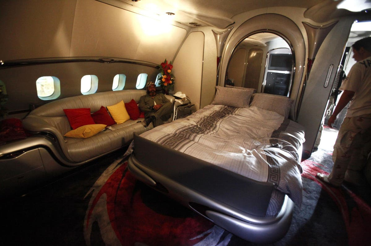 A Libyan rebel fighter sits in a bedroom of Muammar Qaddafi's private plane, at the international airport in Tripoli. (File photo: Reuters)
