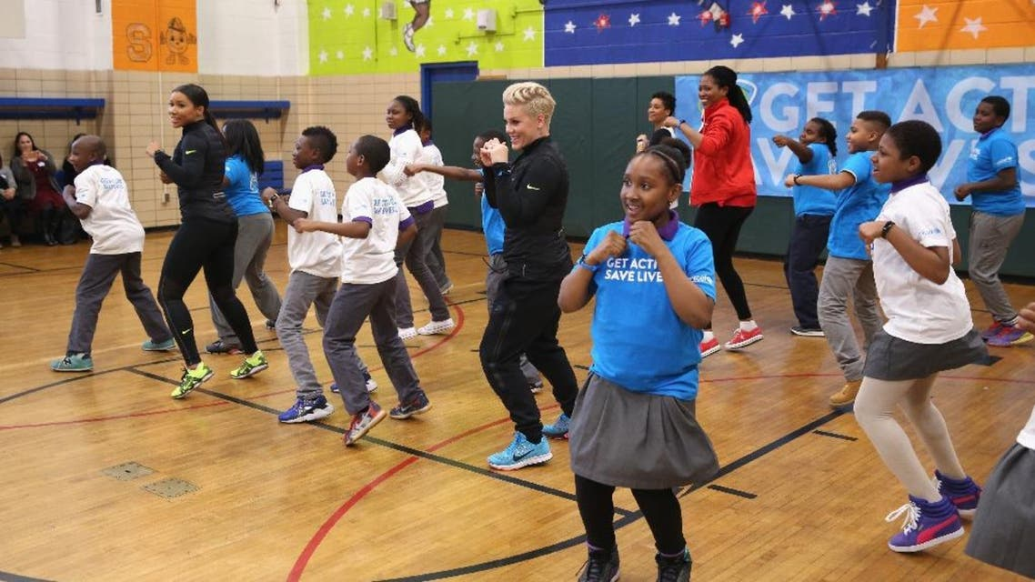 Grammy award winner Pink (C) celebrates nationwide launch of UNICEF Kid Power with New York City school children at PS 242. (AFP)
