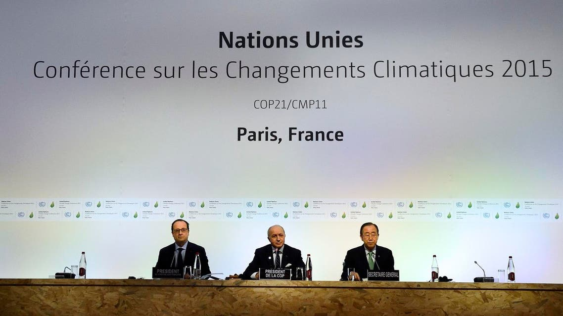 French President Francois Hollande, left, French Foreign Affairs Minister Laurent Fabius and United Nations Secretary General Ban Ki-moon, right, attend a plenary session of the COP21. (AP)
