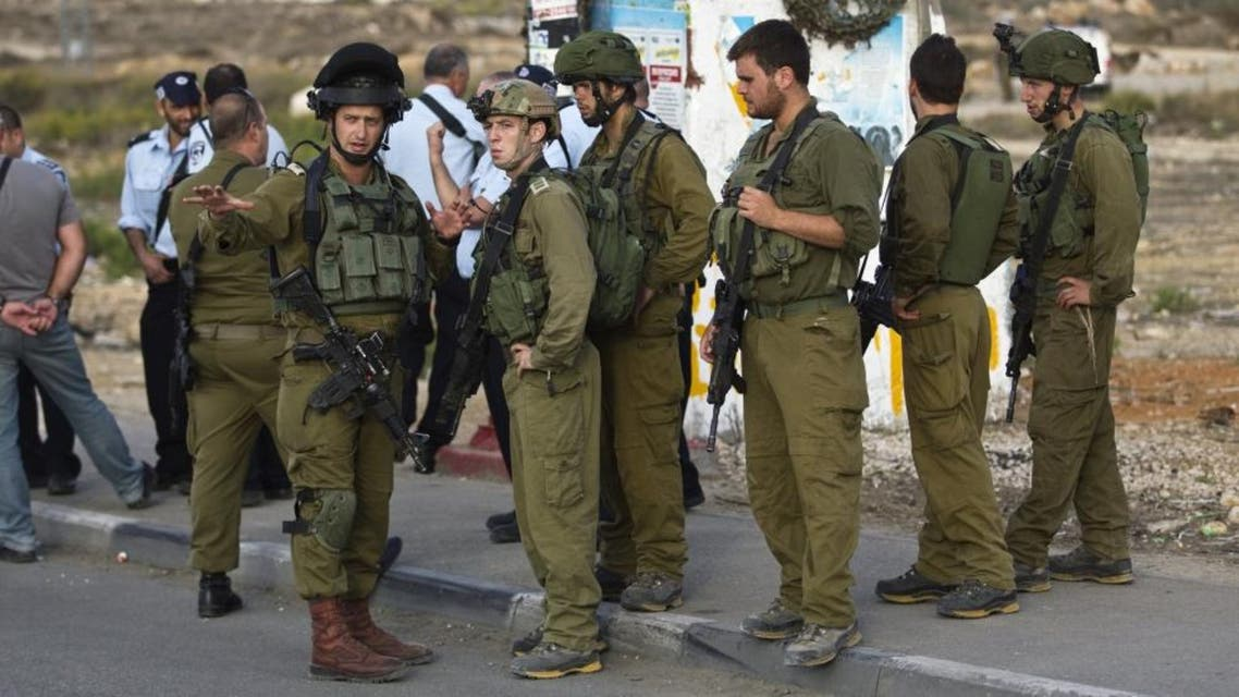 Israeli soldiers stand at the scene where a Palestinian man is suspected of carrying out a running over and stabbing attack near the West Bank Jewish settlement of Efrat, part of the Gush Etzion bloc. (File photo: Reuters)
