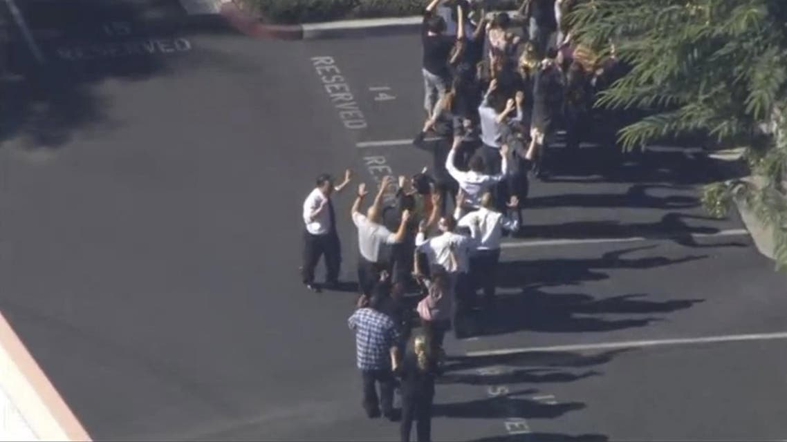 A still image from a video footage courtesy of Nbcla.com shows people lining up as first responders respond to shooting at the California Department of Developmental Services Inland Regional Center, one of 21 facilities serving people with developmental disabilities, in San Bernardino, California December 2, 2015. Three people were killed and as many as 20 were wounded on Wednesday when at least one person opened fire at a social services agency in the Southern California city of San Bernardino, authorities and a witness said. REUTERS/NBCLA.COM/Handout FOR EDITORIAL USE ONLY. NOT FOR SALE FOR MARKETING OR ADVERTISING CAMPAIGNS. THIS IMAGE HAS BEEN SUPPLIED BY A THIRD PARTY. IT IS DISTRIBUTED, EXACTLY AS RECEIVED BY REUTERS, AS A SERVICE TO CLIENTS. NO SALES. MANDATORY CREDIT NO RESALES. NO ARCHIVE