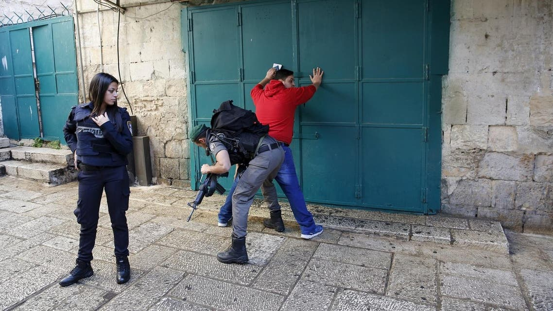 An Israeli border policemen checks on a Palestinian man at the area in Jerusalem's old city. (File photo: Reuters)