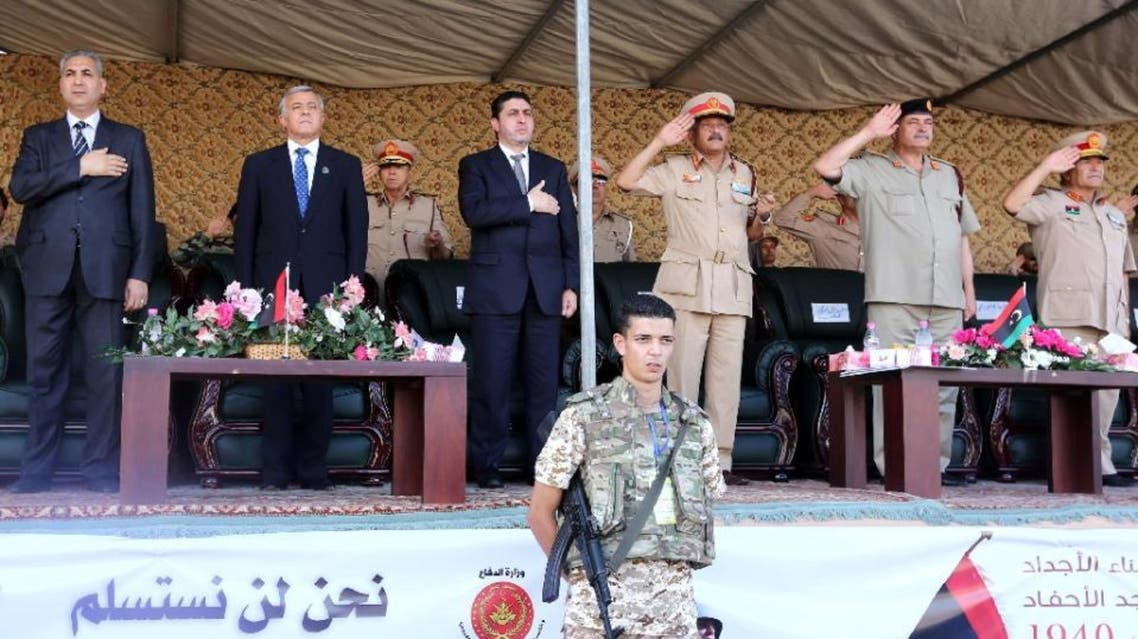 Libya's PM of the self-declared Islamist-backed government in Tripoli, Khalifa Al-Ghweil (C) and head of the General National Congress Nouri Bousahmein (2-L) attend a ceremony in Tripoli, on Aug. 13. (AFP)