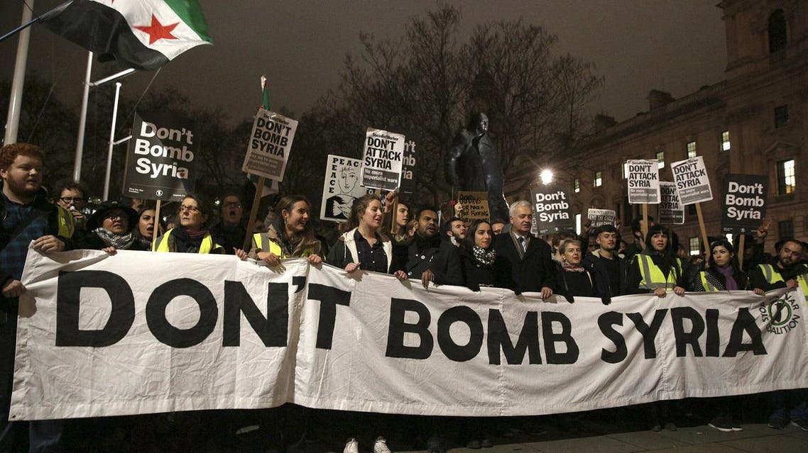 Anti-war protesters demonstrate against proposals to bomb Syria outside the Houses of Parliament in London. (Reuters)