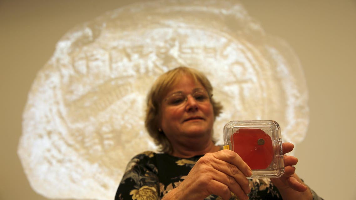 Dr. Eilat Mazar, displays a clay imprint, known as a bulla, which was unearthed from excavations near Jerusalem's Old City, and later discovered to be from the seal of the biblical King Hezekiah, is displayed during a news conference at The Hebrew University in Jerusalem December 2, 2015. REUETRS/Amir Cohen