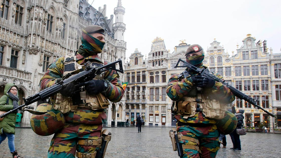 FILE - In this Tuesday, Nov. 24, 2015 file photo, Belgium police officers patrol the Grand Place in central Brussels. A four day lockdown due to a heightened security threat closed the capital's subways and schools. Officials recommended that popular shopping districts be shuttered and advised people to avoid public places since they could be targeted by extremists. (AP Photo/Michael Probst, File)