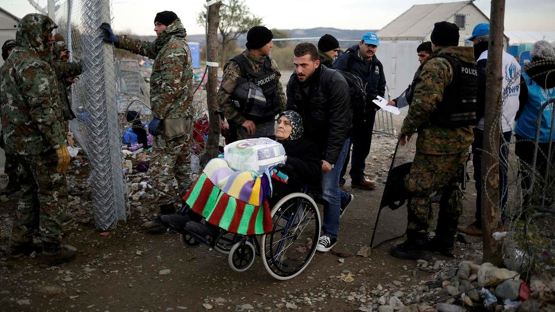 Elderly migrant in wheelchair crosses Macedonian-Greek border near Gevgelija. (File photo: Reuters)