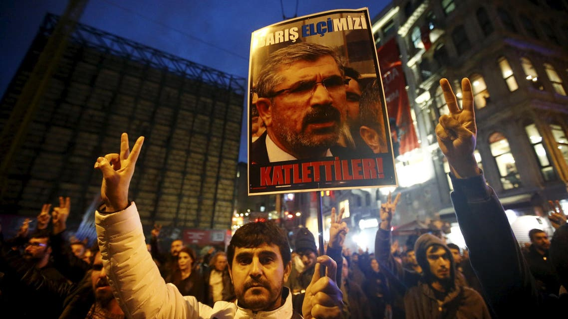A demonstrator holds picture of Bar Association President Tahir Elci during a protest in Istanbul, Turkey, November 28, 2015. An unidentified gunman on Saturday killed a top Kurdish lawyer who had been criticised in Turkey for saying the banned Kurdistan Workers Party (PKK) was not a terrorist organisation. Witnesses said Bar Association President Tahir Elci was shot in the head after making a statement to the media in Diyarbakir, the largest city in Turkey's troubled, mainly Kurdish southeast. REUTERS/Osman Orsal