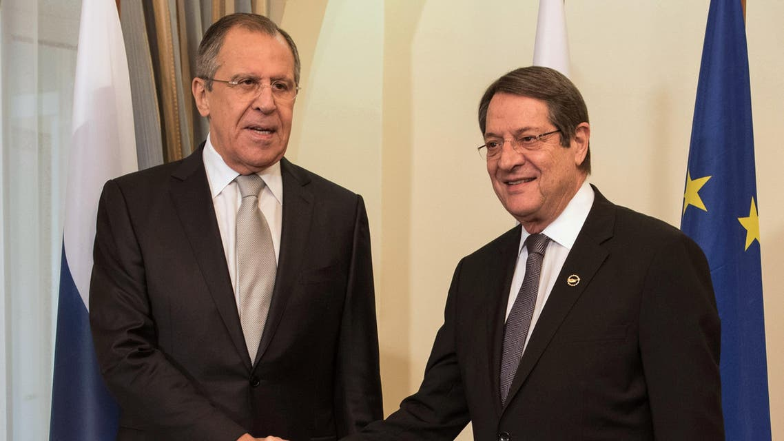 Russian Foreign Minister, Sergey Lavrov, left, and Cyprus' President, Nicos Anastasiades, shake hands before their meeting at the presidential palace in Nicosia, Wednesday, Dec. 2, 2015. Lavrov is in Cyprus for a 24-hour official visit. (Iacovos Hadjistavrou/Pool Photo via AP)