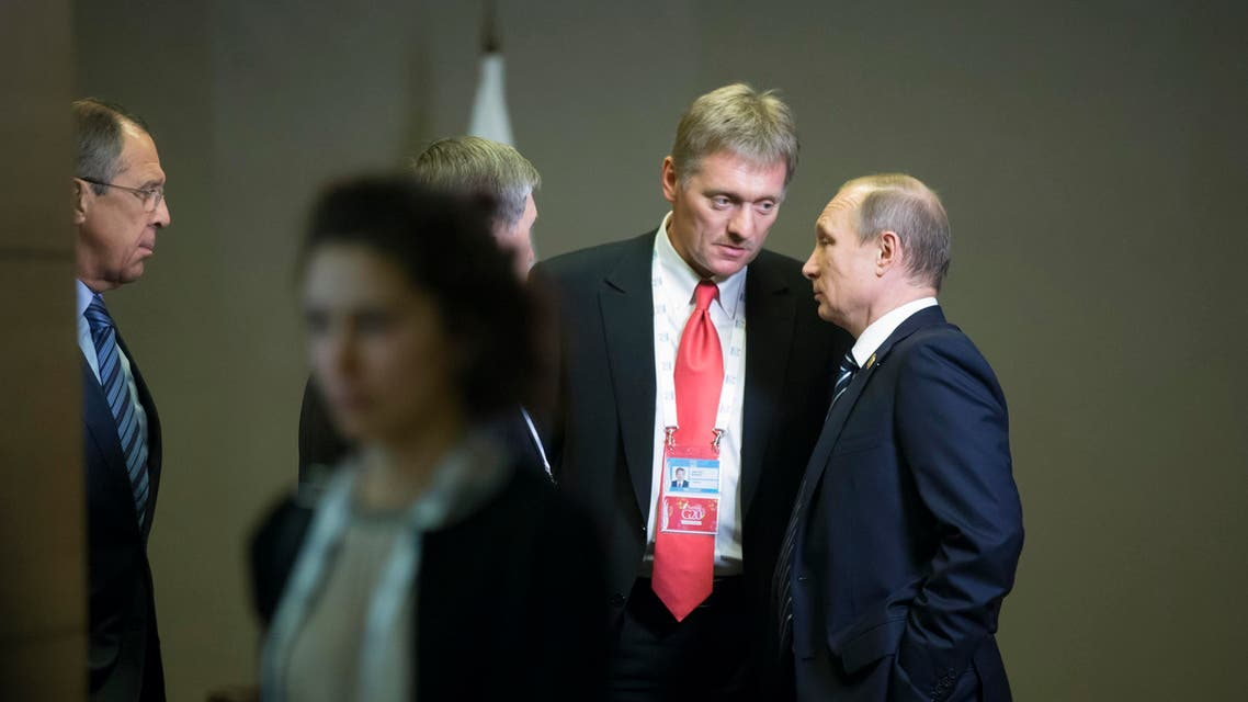 Russian President Vladimir Putin, right, speaks to his press secretary Dmitry Peskov, second right, as Russian Foreign Minister Sergey Lavrov, left, looks at them after their talks with British Prime Minister David Cameron at the G-20 Summit in Antalya, Turkey, Monday, Nov. 16, 2015. (AP Photo/Alexander Zemlianichenko)