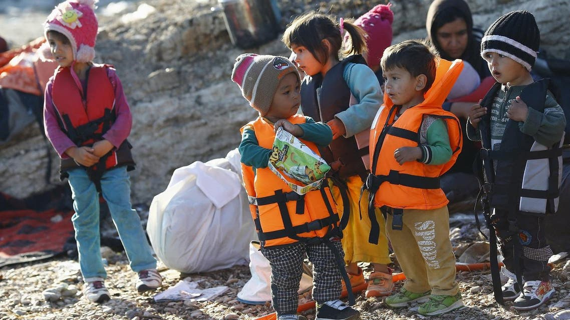 Refugee children wearing life jackets wait for a dinghy to sail off for the Greek island of Chios from the western Turkish coastal town of Cesme. (Reuters)