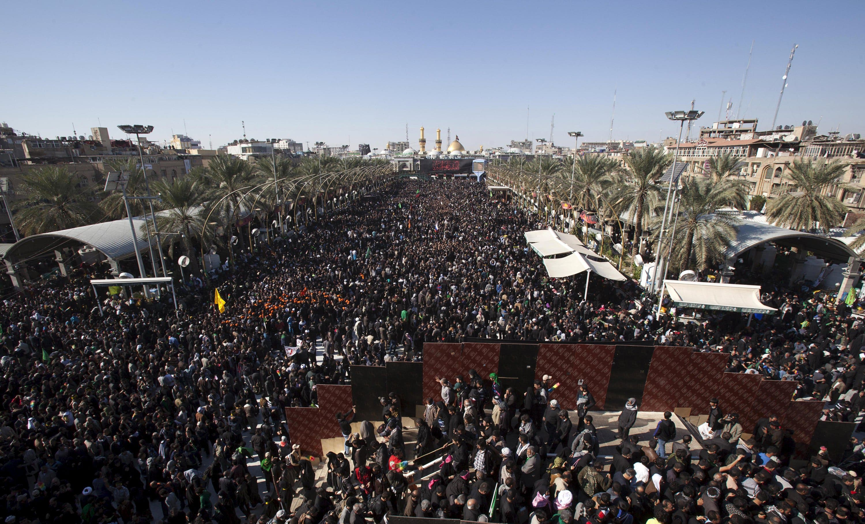 Shi'ite Muslim pilgrims gather for a religious ceremony to observe Arbaeen, which marks the end of a 40-day mourning period following Ashura, in Kerbala, south of Baghdad, December 3, 2015.
