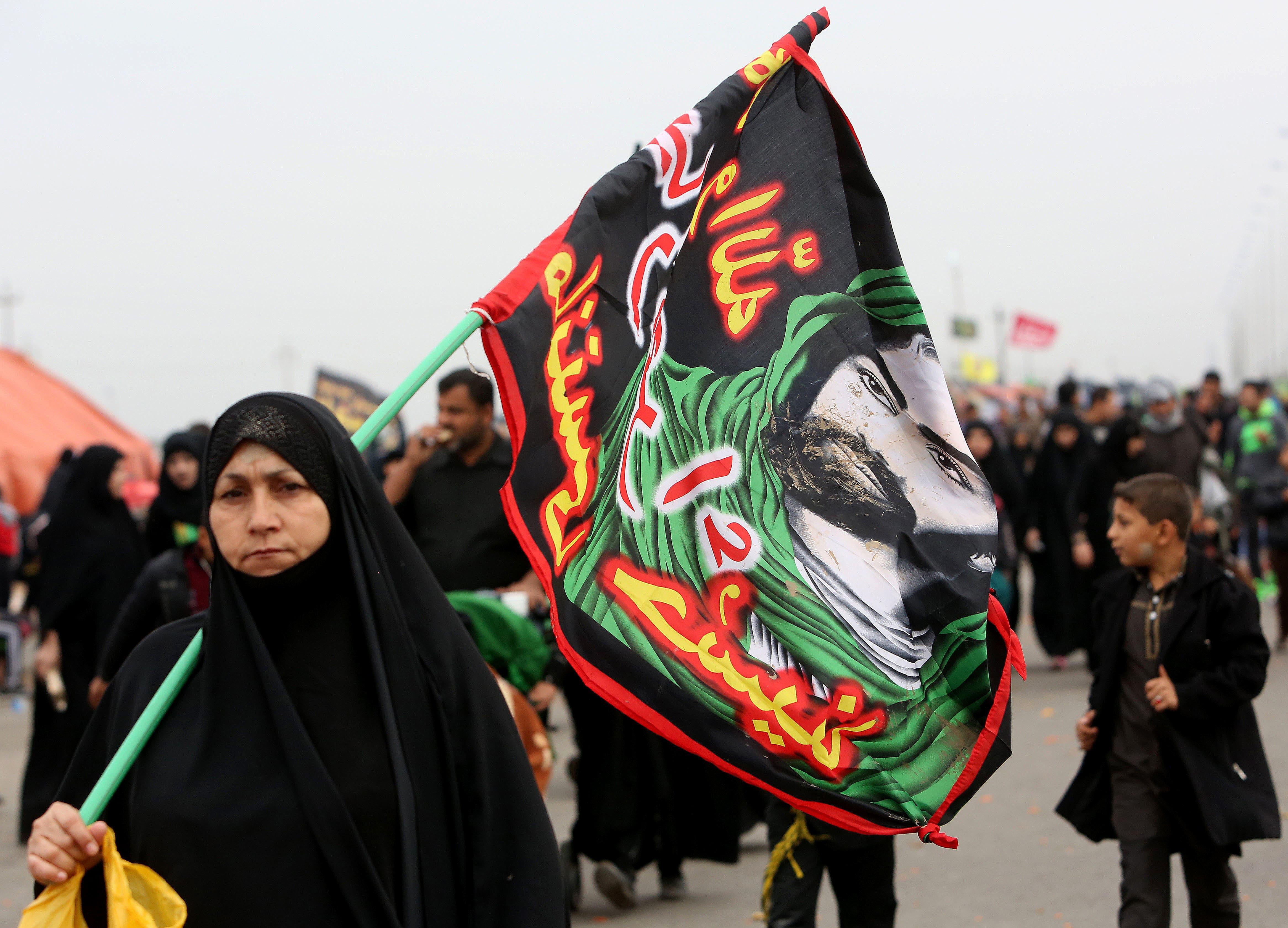 Shiite pilgrims make their way to Karbala for Arbaeen, in Basra, 340 miles (550 kilometers) southeast of Baghdad, Iraq, Thursday, Dec. 3, 2015.