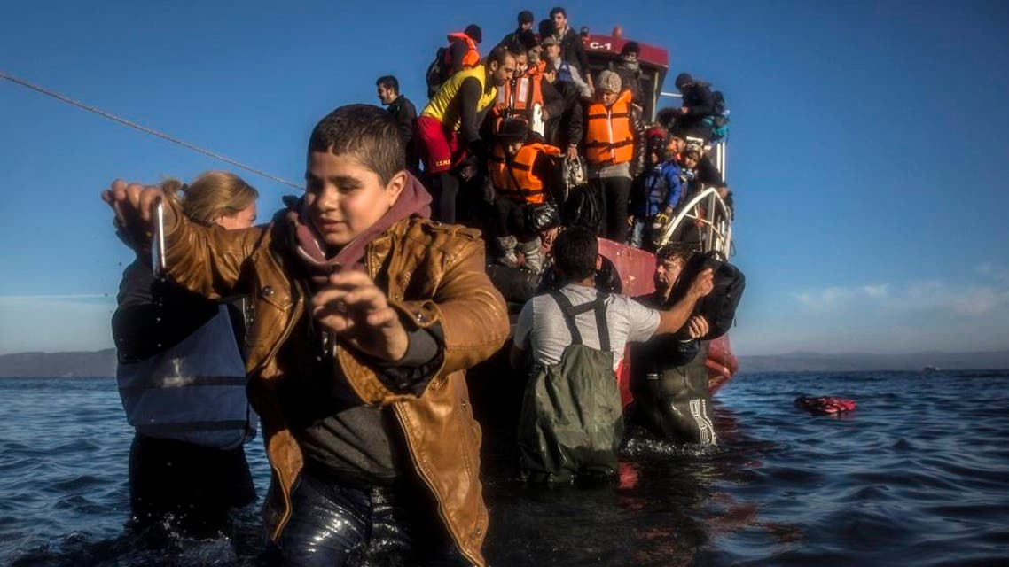 Refugees, mostly from Syria and Iraq, disembark a vessel on the Greek island of Lesbos after setting sail from Turkey. (AP Photo)