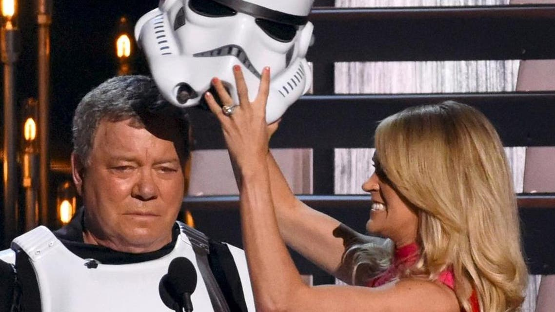 """Show host Carrie Underwood removes the helmet off a """"Star Wars"""" Storm Trooper, revealing that actor William Shatner of """"Star Trek"""" fame was inside, onstage at the 49th Annual Country Music Association Awards in Nashville, Tennessee. (Reuters)"""