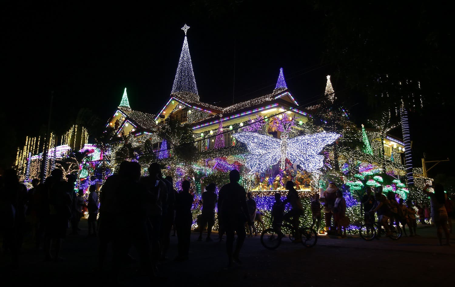 The house is drawing huge crowds, especially during weekends, with visitors using the bright lights and festive Christmas decors as their backdrop for selfies with families and friends. (AP)