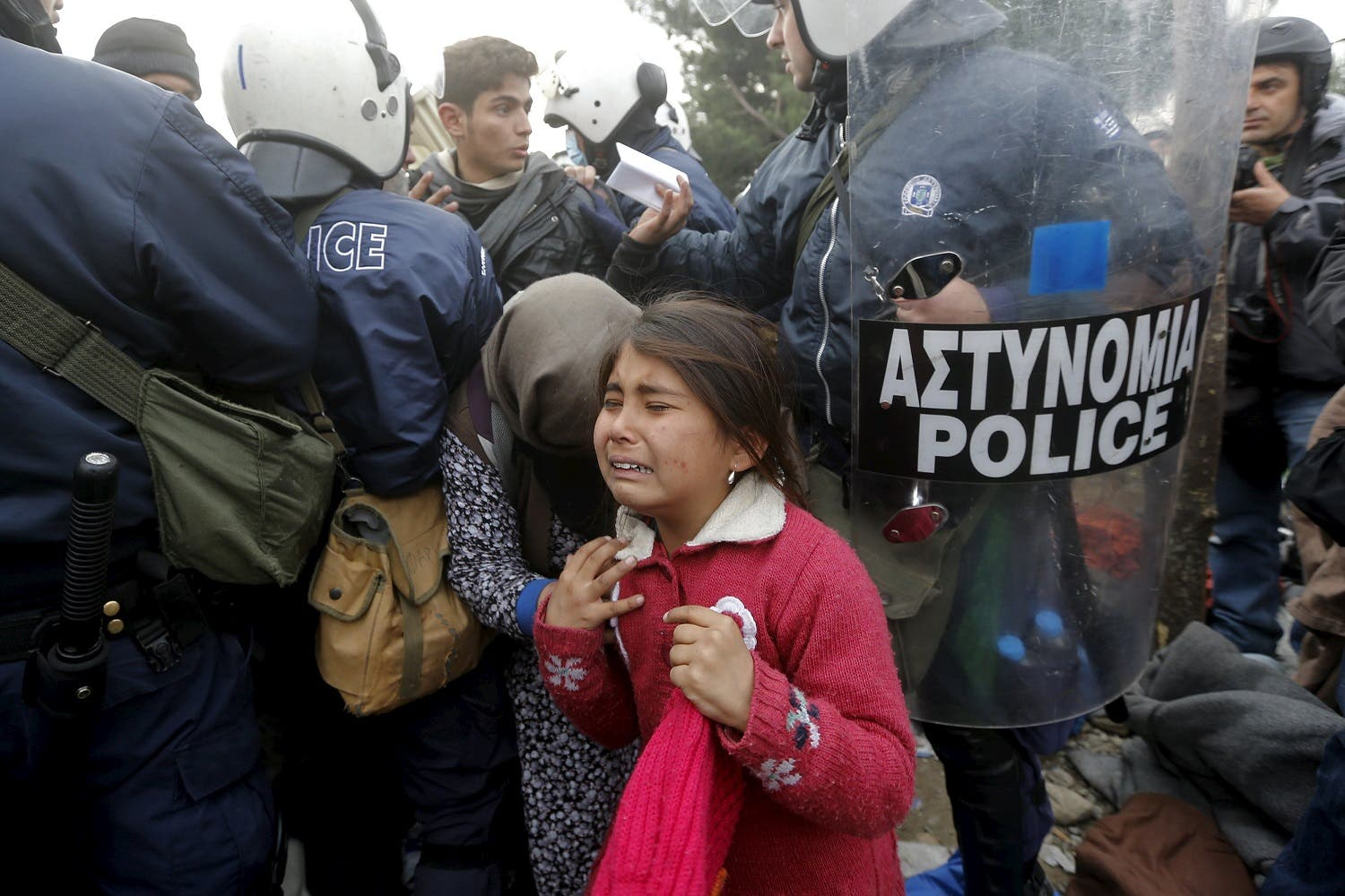 A refugee girl cries after passing through a Greek police cordon before crossing the Greek-Macedonian border near the village of Idomeni. (Reuters)