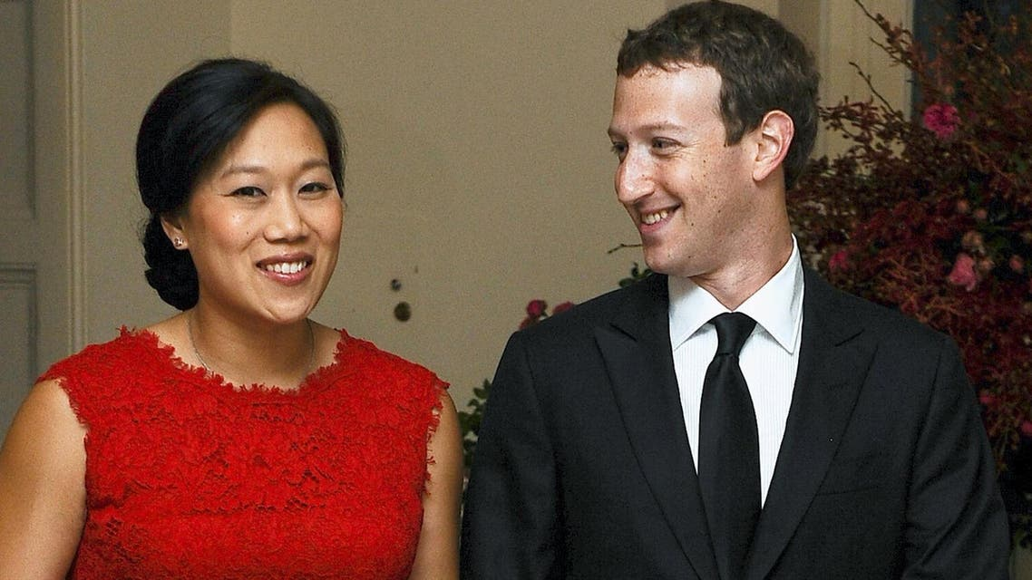 Mark Zuckerberg, Chairman and CEO of Facebook, and his wife Priscilla Chan arrive for an official State dinner at the White House in Washington, in this September 25, 2015 file photo. Reuters