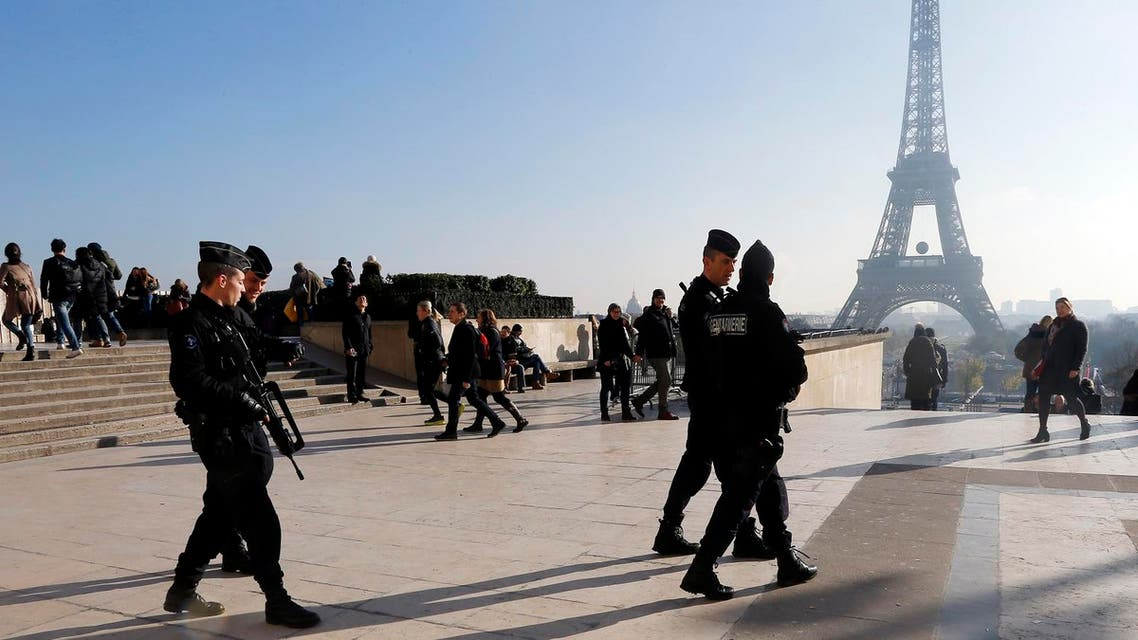 French police officers patrol near the Eiffel Tower, in Paris, Monday Nov. 23. (AP)