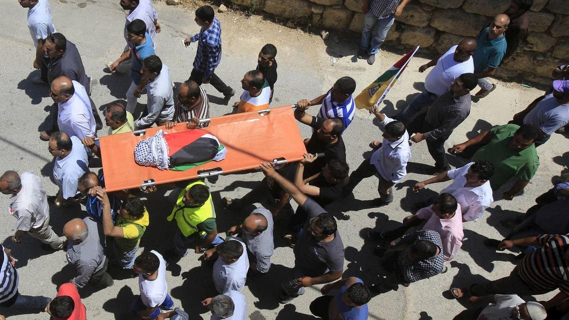 Mourners carry the body of 18-month-old Palestinian baby Ali Dawabsheh, who was killed after his family's house was set to fire in a suspected attack by Jewish extremists in Duma village near the West Bank city of Nablus. (File photo: Reuters)