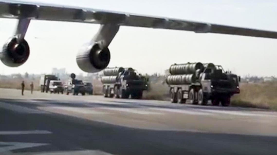 Russian S-400 air defense missile systems travel along the runway at the Hemeimeem air base in Syria, about 50 kilometers (30 miles) south of the border with Turkey. (AP)