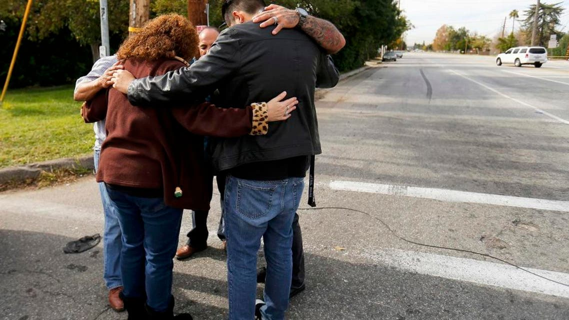 Local residents as they wait to return to their homes near the scene of the investigation of an SUV where two suspects were shot by police following a mass shooting in San Bernardino, California December 3, 2015. Authorities on Thursday were working to determine why Syed Rizwan Farook 28, and Tashfeen Malik, 27, opened fire at a holiday party of his co-workers in Southern California, killing 14 people and wounding 17 in an attack that appeared to have been planned. REUTERS/Mike Blake