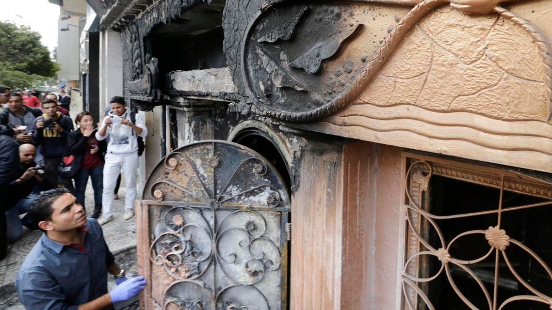 An Egyptian forensic member checks the entrance of a nightclub which was attacked in Cairo. (AP)