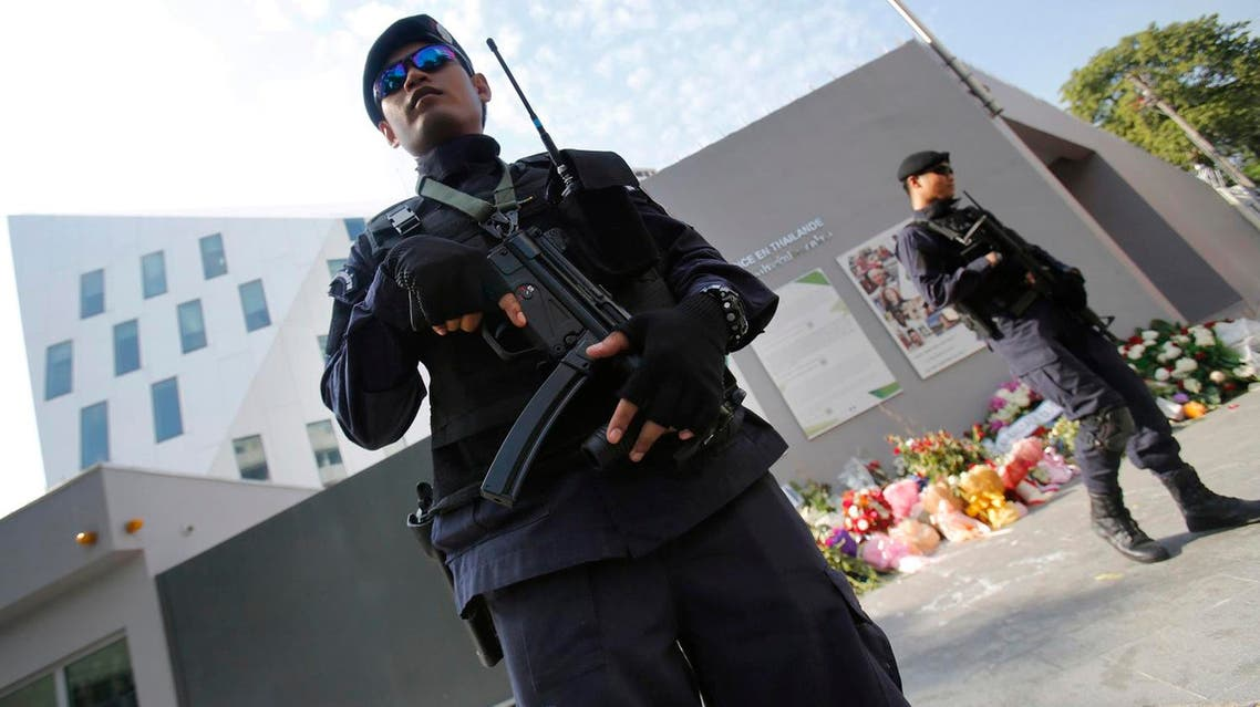 Thai police officers stand guard outside French Embassy in Bangkok, Thailand. (AP)