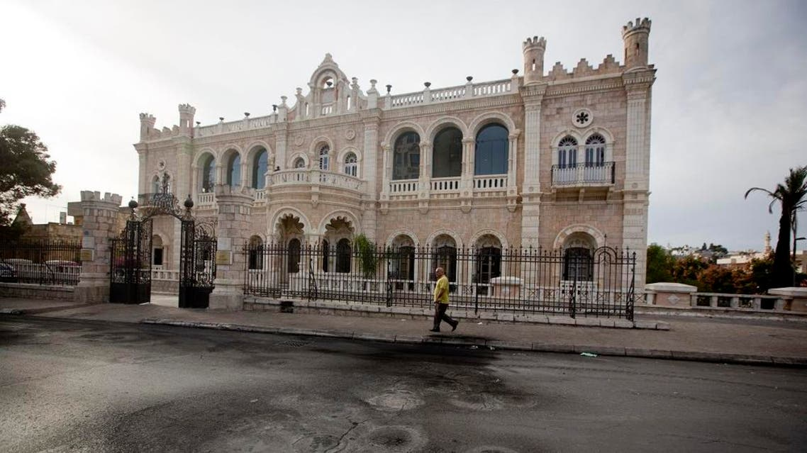 This Saturday, Nov. 28, 2015 photograph shows burnt tire marks in front of the Intercontinental hotel, in the West Bank town of Bethlehem. The century-old Jacir Palace hotel, with its soaring stone archways and wrought iron balconies, was once a symbol of Bethlehem's wealth and tourism potential. Today, the property reflects the city's dour mood ahead of the crucial Christmas season after months of unrest that has taken more than 100 lives, including a Palestinian waiter from the hotel. (AP Photo/Majdi Mohammed)