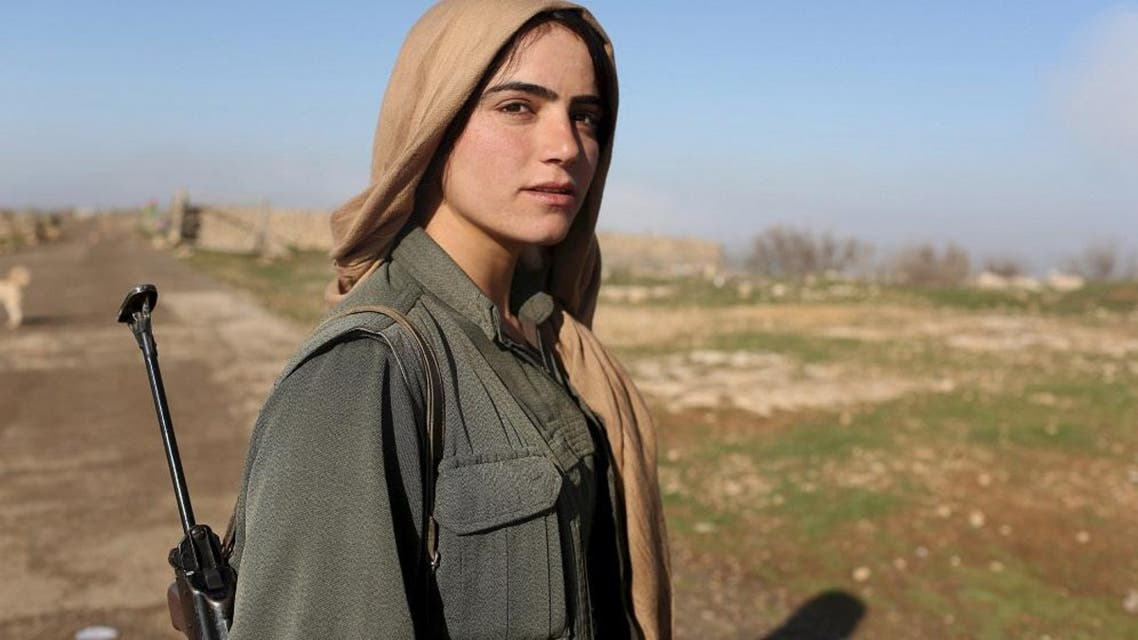 A female Kurdistan Workers Party (PKK) fighter stands near a security position in Sinjar, Iraq March 13, 2015. REUTERS/Asmaa Waguih