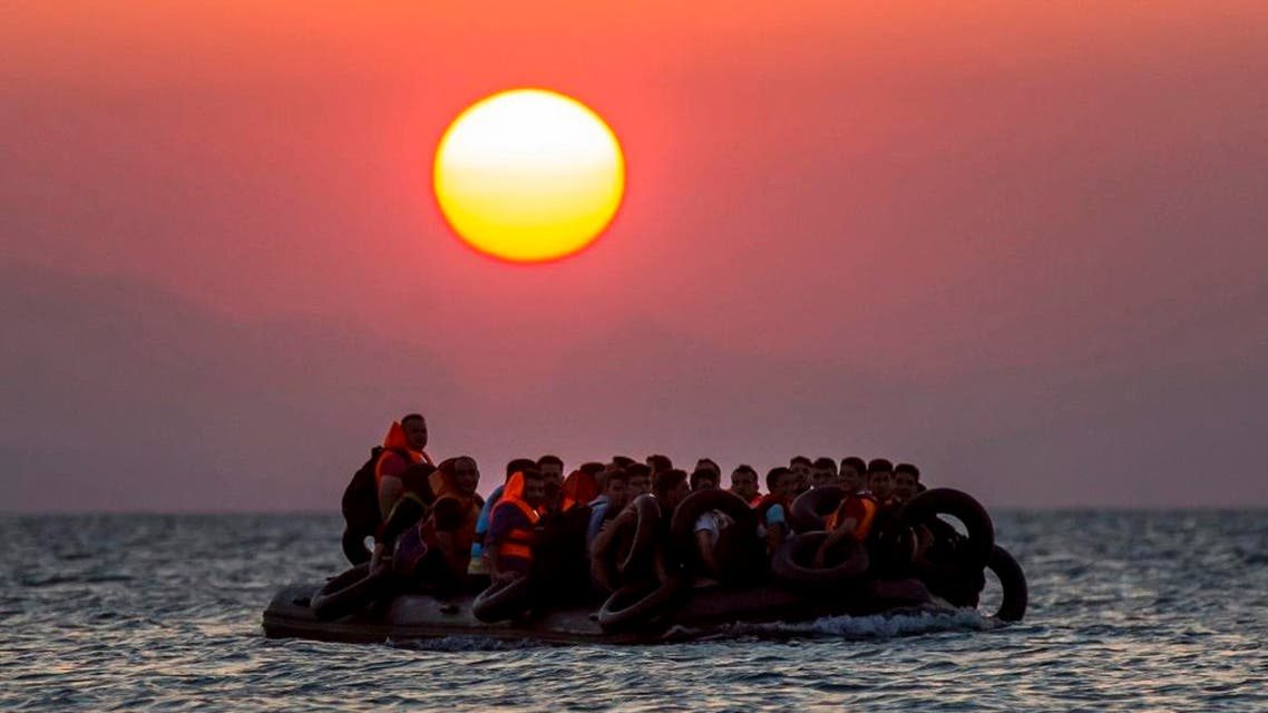 Migrants on a dinghy arrive at the island of Kos, Greece, after crossing from Turkey. (File photo: AP)