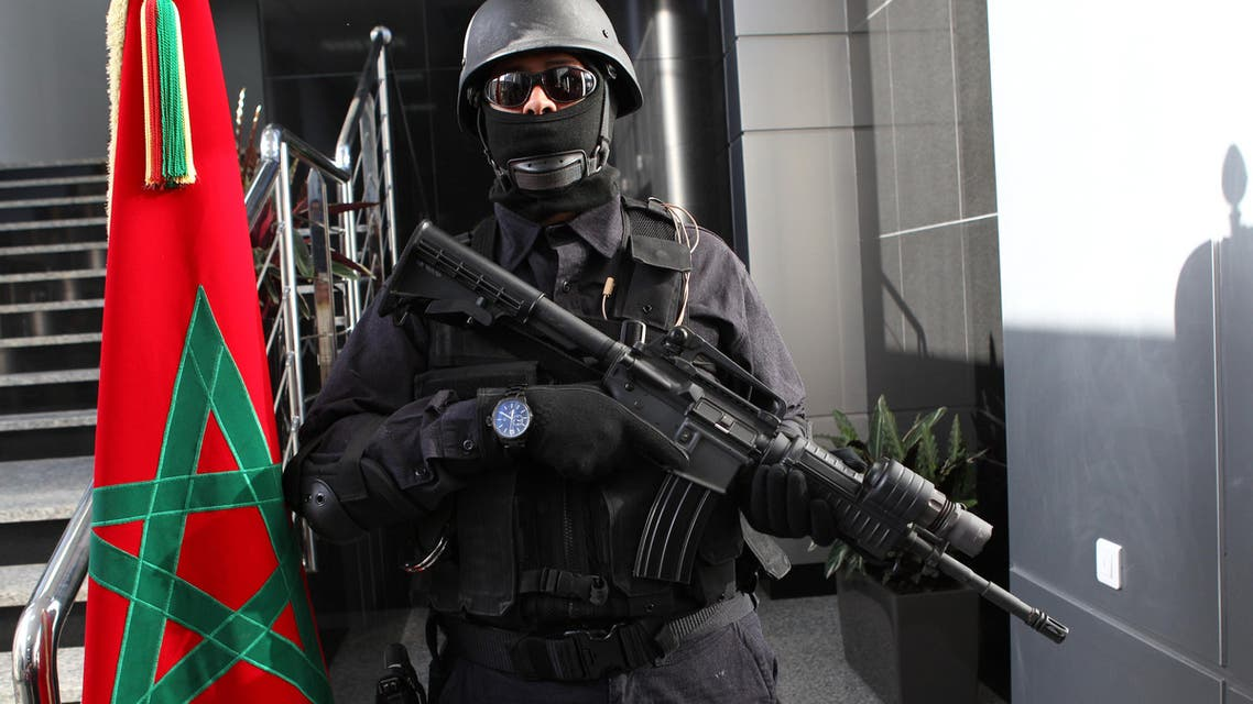 A Moroccan special anti-terror units poses in the new headquarters of the Central Bureau of Judicial Investigations in Sale, near Rabat, Morocco, Monday April 20, 2015.