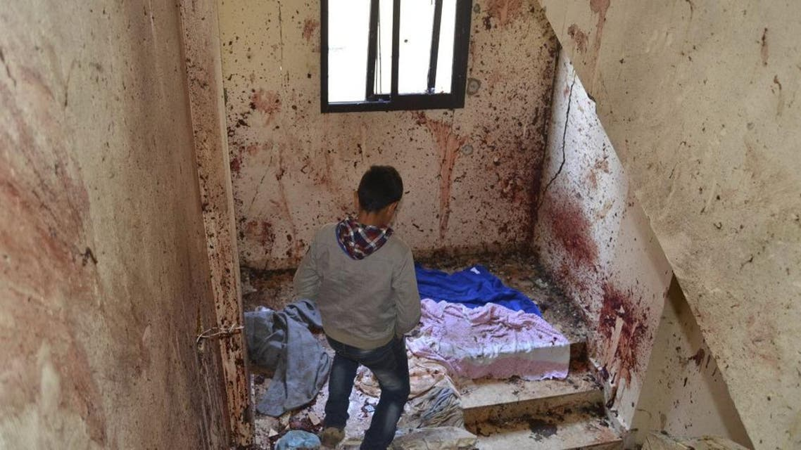 A boy walks down a staircase with splashed blood on the walls of a staircase caused by an explosion inside a building in Deir Ammar town, northeast from the city of Tripoli, Lebanon December 5, 2015. reuters