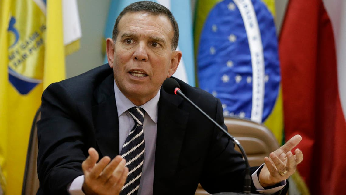 In this May 21, 2015 file photo, CONMEBOL President Juan Angel Napout talks during a press conference in Asuncion, Paraguay.