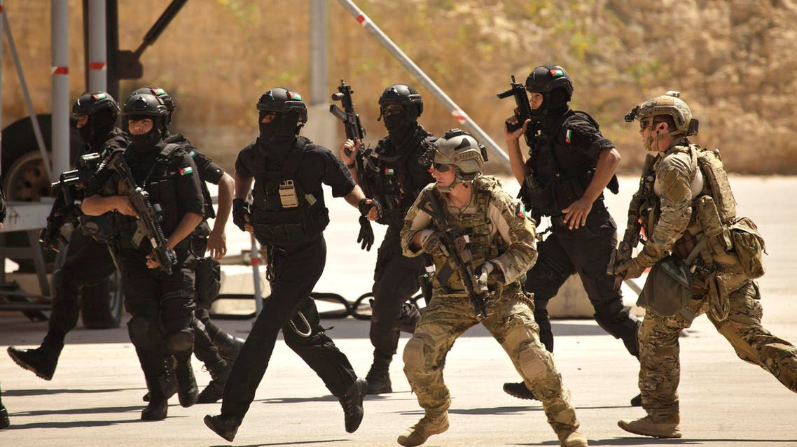 In this Thursday, June 20, 2013 file photo, special operations forces from Jordan and the U.S. conduct a combined demonstration with commandos from Iraq,