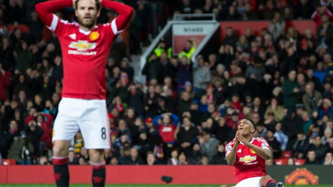 Manchester United's Anthony Martial, right, and Juan Mata react after a missed opportunity during the English Premier League soccer match between Manchester United and West Ham United at Old Trafford Stadium, Manchester, England, Saturday, Dec. 5, 2015. (AP Photo/Jon Super)