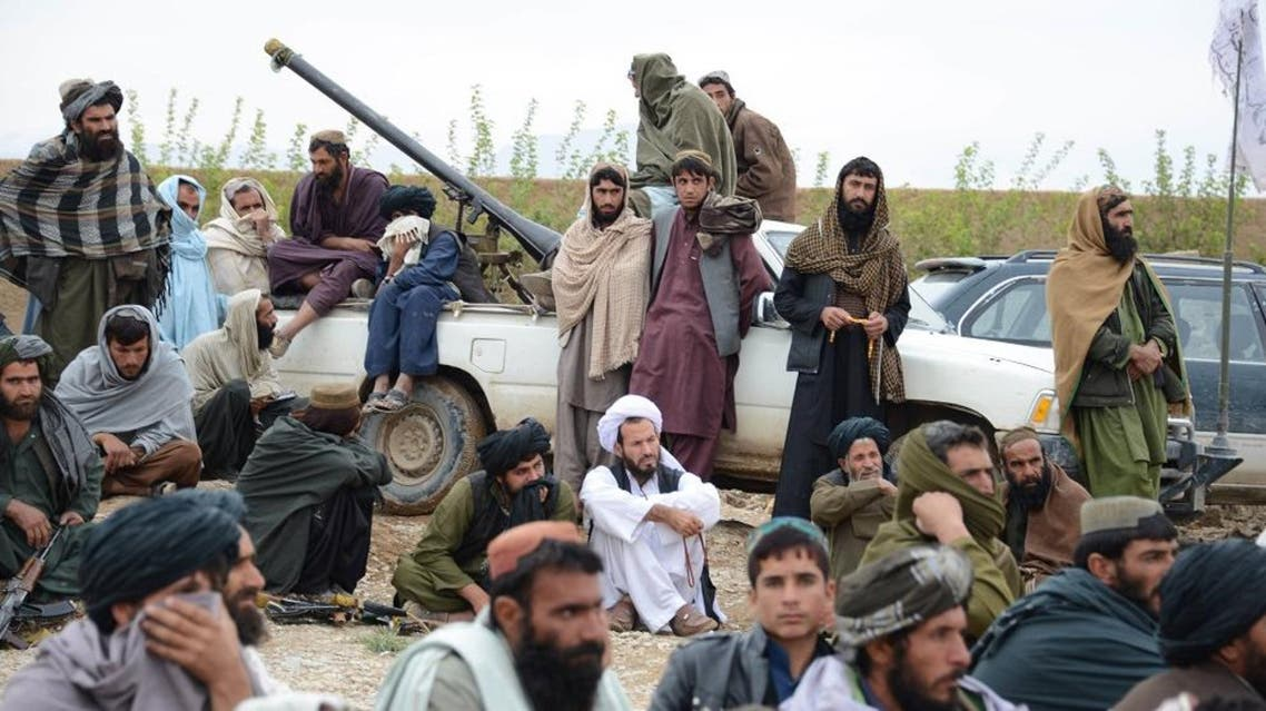 In this Tuesday, Nov. 3, 2015 photo, Afghan Taliban fighters listen to Mullah Mohammed Rasool, unseen, the newly-elected leader of a breakaway faction of the Taliban, in Farah province, Afghanistan. (AP Photo)