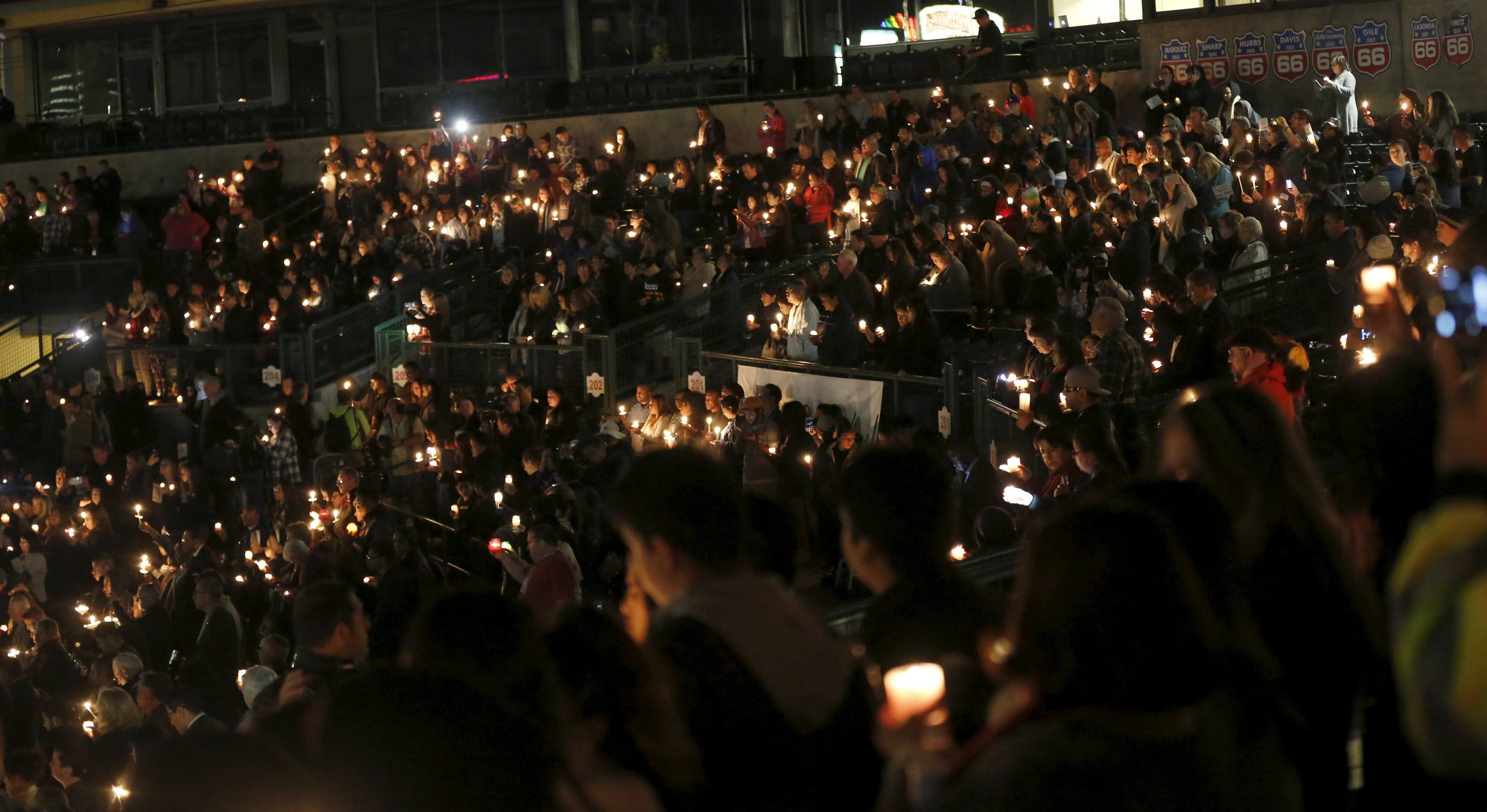 Attendees reflect on the tragedy of Wednesday's attack during a candlelight vigil in San Bernardino, California December 3, 2015.